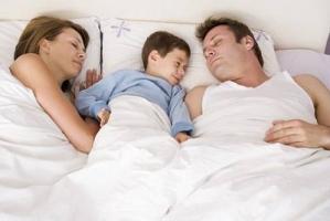 child-sleeping-parents