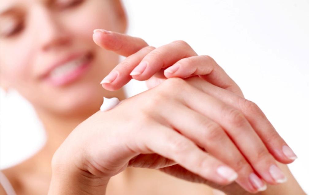 woman-applying-hand-cream-winter