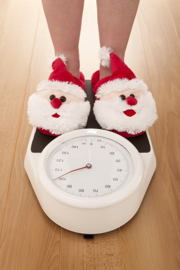 Santa Claus slippers on weight scales