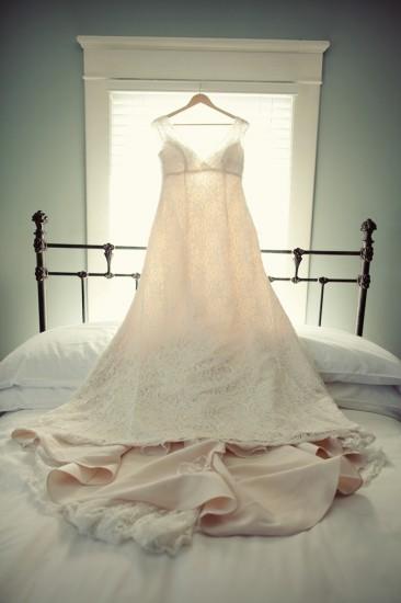 hanging-wedding-dress-over-bed