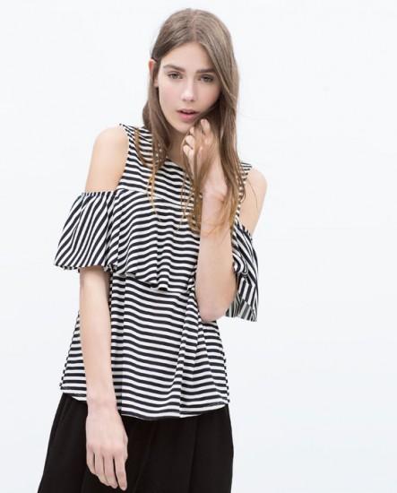 Top με βολάν και ακάλυπτους ώμους Zara (15,99€)