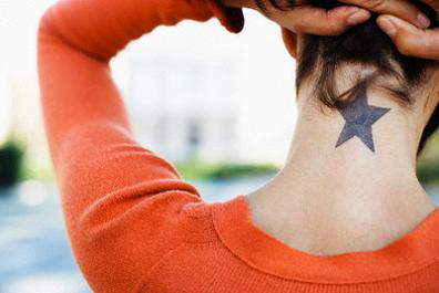 Woman Showing Her Star Tattoo