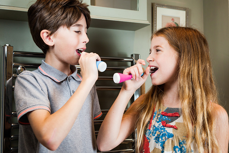 Playbrush-works-with-multiple-toothbrushes-and-can-be-safely-shared-amongst-siblings