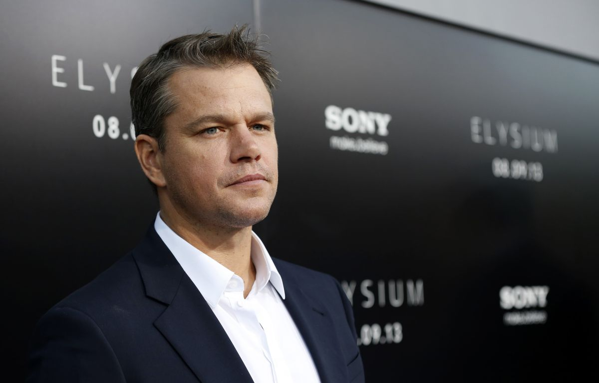 "Matt Damon poses at the world premiere of ""Elysium"" in Los Angeles"