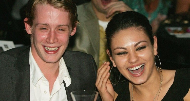 """LAS VEGAS - OCTOBER 15:  Actor Macaulay Culkin (L) and actress Mila Kunis attend the launch of the """"uBid for Hurricane Relief"""" charity auction and benefit at the Empire Ballroom October 15, 2005 in Las Vegas, Nevada. All of the proceeds from the auction will be split evenly between the Brett Favre Fourward Foundation, the RockWorks Foundation and the Child Welfare League of America. The organizations will use money raised to help areas in the Gulf Coast devastated by Hurricane Katrina and Hurricane Rita. The online part of the auction continues on uBid.com through November 1, 2005.  (Photo by Ethan Miller/Getty Images)"""