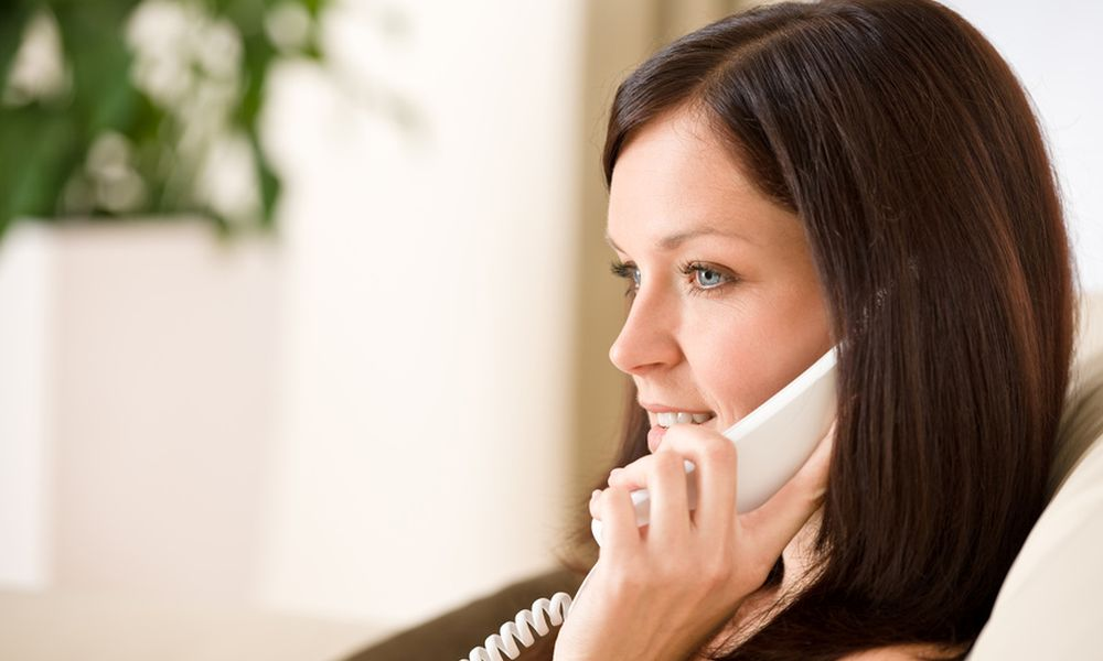 On the phone home: woman calling