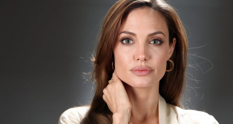 **PREMIUM CONTENT--HIGHER RATES APPLY** Actress Angelina Jolie poses for a portrait to promote her directorial debut of the film 'In the Land of Blood and Honey' Saturday, Dec. 3, 2011 in New York City.  (AP Photo/Carlo Allegri)