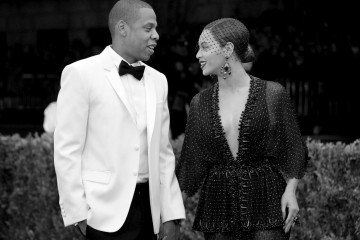 """NEW YORK, NY - MAY 05: (EDITORS NOTE: Image was converted to black and white.)   Jay-Z (L) and Beyonce attend the """"Charles James: Beyond Fashion"""" Costume Institute Gala at the Metropolitan Museum of Art on May 5, 2014 in New York City.  (Photo by Mike Coppola/Getty Images)"""