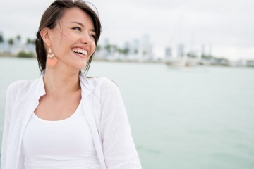 Happy casual woman laughing and having fun