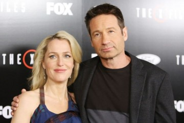 """LOS ANGELES, CA - JANUARY 12:  Gillian Anderson (L) and David Duchovny arrive at the Los Angeles premiere of Fox's """"The X-Files"""" held at California Science Center on January 12, 2016 in Los Angeles, California.  (Photo by Michael Tran/FilmMagic)"""