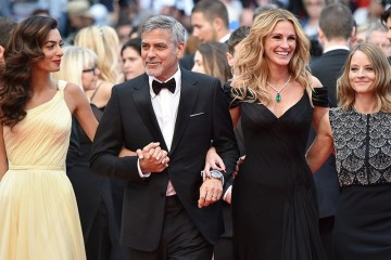 "US director Jodie Foster (R) arrives on May 12, 2016 with US actor George Clooney (2ndL) and his wife, British-Lebanese lawyer Amal Clooney (L) and US actress Julia Roberts for the screening of the film ""Money Monster"" at the 69th Cannes Film Festival in Cannes, southern France.  / AFP PHOTO / ALBERTO PIZZOLIALBERTO PIZZOLI/AFP/Getty Images"