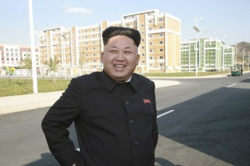 North Korean leader Kim Jong Un gives field guidance to the newly built Wisong Scientists Residential District in this undated photo released by North Korea's Korean Central News Agency (KCNA) in Pyongyang October 14, 2014. Kim, shown using a cane for support, re-appeared in state media on Tuesday after a lengthy public absence that had fuelled speculation over his health and grip on power in the secretive, nuclear-capable country.  REUTERS/KCNA (NORTH KOREA - Tags: POLITICS TPX IMAGES OF THE DAY) ATTENTION EDITORS - THIS PICTURE WAS PROVIDED BY A THIRD PARTY. REUTERS IS UNABLE TO INDEPENDENTLY VERIFY THE AUTHENTICITY, CONTENT, LOCATION OR DATE OF THIS IMAGE. FOR EDITORIAL USE ONLY. NOT FOR SALE FOR MARKETING OR ADVERTISING CAMPAIGNS. THIS PICTURE IS DISTRIBUTED EXACTLY AS RECEIVED BY REUTERS, AS A SERVICE TO CLIENTS. NO THIRD PARTY SALES. NOT FOR USE BY REUTERS THIRD PARTY DISTRIBUTORS. SOUTH KOREA OUT. NO COMMERCIAL OR EDITORIAL SALES IN SOUTH KOREA - RTR4A38M