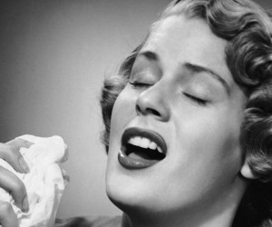 UNITED STATES - CIRCA 1950s:  Woman sneezing.  (Photo by George Marks/Retrofile/Getty Images)