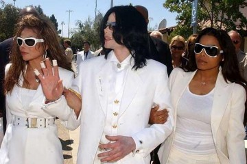 FILE PHOTO:  Michael Jackson Hospitalized...SANTA MARIA, CA - AUGUST 16:  (FILE PHOTO) Defendant Michael Jackson with sisters LaToya Jackson (L) and Janet Jackson exit the Santa Maria courthouse for break during the evidentiary hearing in the Michael Jackson child molestation case August 16, 2004 in Santa Maria, California. The iconic pop star, 50, was rushed to a Los Angeles hospital June 25, 2009 after going into cardiac arrest, receiving CPR in the ambulance, according to reports.   (Photo by Ed Souza-Pool/Getty Images)