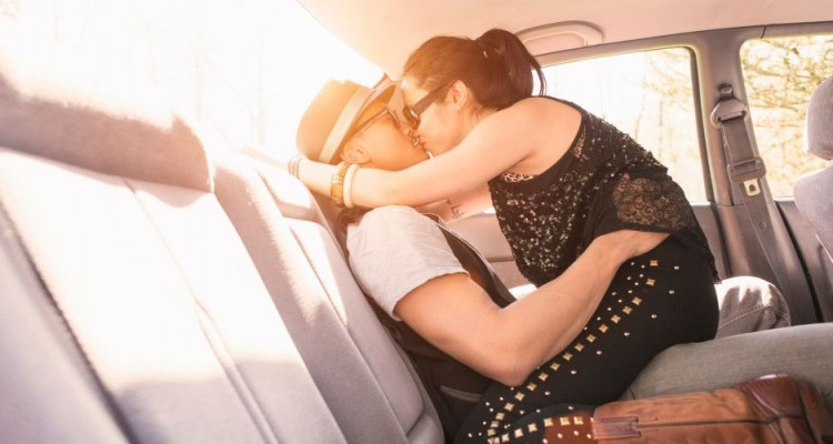 Couple in car, kissing