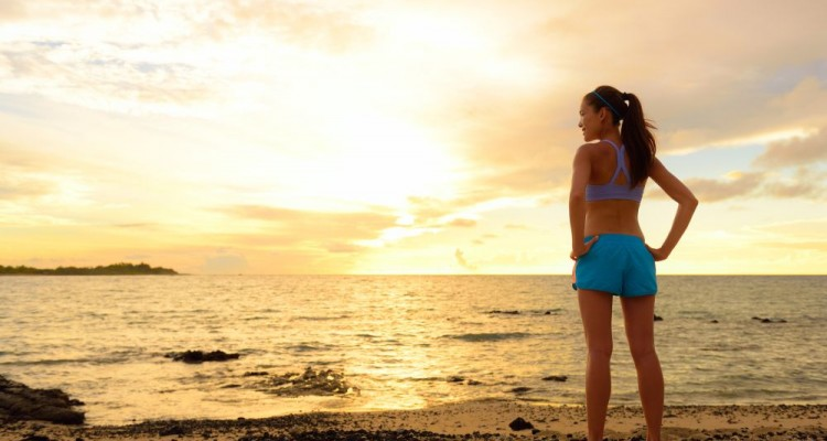 Aspirations - woman looking away with inspiration. Fitness woman