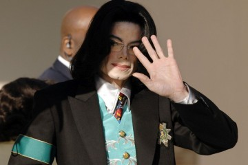 SANTA MARIA, UNITED STATES:  Michael Jackson waves to fans as he arrives 21 April, 2005 at Santa Barbara County Court in Santa Maria, CA for his child molestation trial. A former Neverland Ranch security officer told Michael Jackson's child sex trial 20 April that guards were ordered not to let the star's future accuser leave the estate.  AFP PHOTO/Stan HONDA  (Photo credit should read STAN HONDA/AFP/Getty Images)