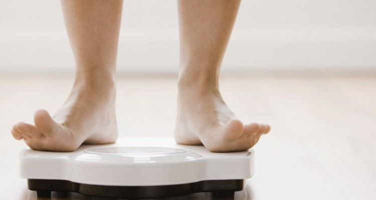 Caucasian woman's feet standing on scale
