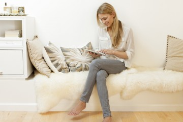Woman  using digital tablet in home