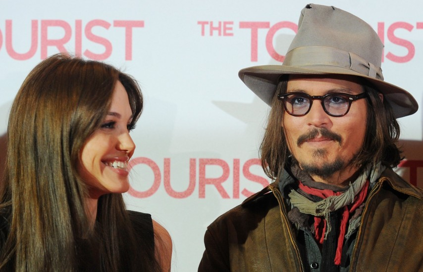 US actors Angelina Jolie (L) and Johnny Depp (R) attend the photocall for the German premiere of their new film 'The Tourist' at Adlon hotel in Berlin, Germany, 14 December, 2010. 'The Tourist' will be in Germany from 16 December on. Photo by Jens Kalaene/DPA/ABACAPRESS.COM