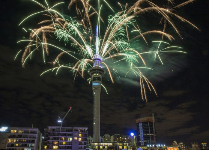 Fireworks explode off Auckland's Skytower as the New Year is welcomed to New Zealand, Jan 1, 2017. (Peter Meecham/New Zealand Herald via AP)