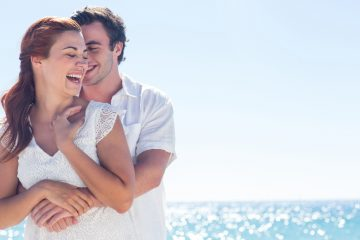 laughing-young-couple-on-beach