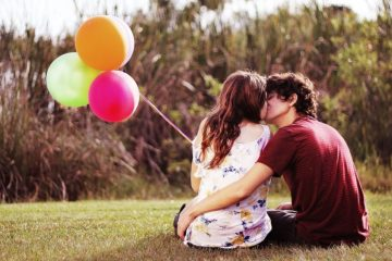 lovely-couple-kissing-in-nature-21577888