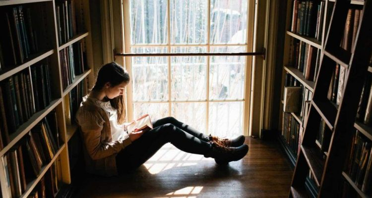 Young-Woman-Reading-Book