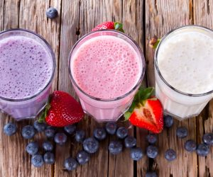 Fresh milk, strawberry, blueberry and banana drinks on wodeen table, assorted protein cocktails with fresh fruits. ; Shutterstock ID 182683421; PO: Brandon for Food