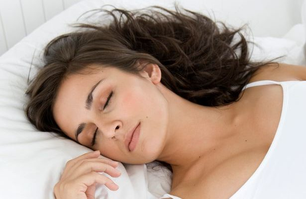 Young-woman-sleeping-in-bed