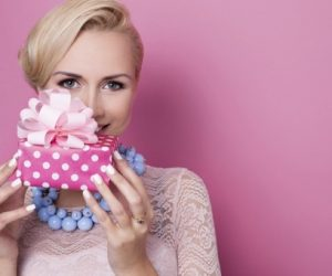 woman_holding_gift_000052221060