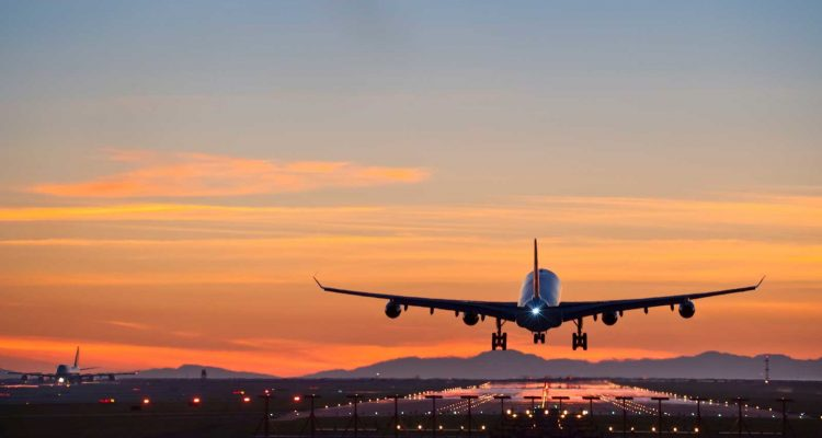 Airbus A340 landing at dusk at Vancouver international airport.